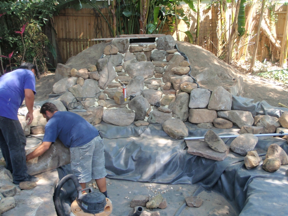 Koi pond construction during doyle land systems for Concrete fish pond construction and design